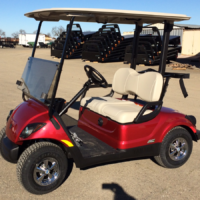 Yamaha YDRE AC electric golf cart in Jasper Red Driver's side view