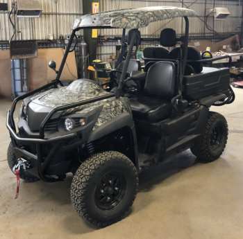 Columbia Vanish 4WD Electric UTV front driver side view in shop