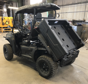 Columbia Vanish 4WD Electric UTV rear driver side view of dump box in shop