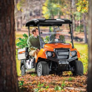 Yamaha UMAX2 gas utility vehicle fire orange between trees