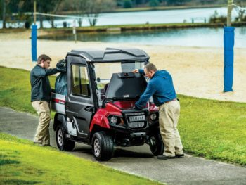 Yamaha UMAX2 AC electric utility cart in Jasper red with enclosure and trunk open