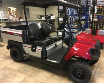 Yamaha UMAX2 AC electric utility cart in Jasper red in showroom