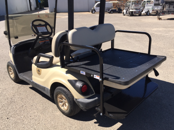 2015 Yamaha 4-seater elec cart for sale has rear flip seat flipped down for cargo bed